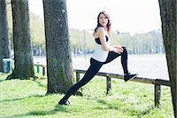 stretching (people exercising) - Young woman warming up on low fence Stock Photo - Premium Royalty-Freenull, Code: 649-07585672