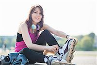 roller skate - Young woman putting on rollerblades Stock Photo - Premium Royalty-Freenull, Code: 649-07585675