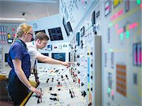 supply - Female operator and trainee in nuclear power station control room simulator Stock Photo - Premium Royalty-Freenull, Code: 649-07585703