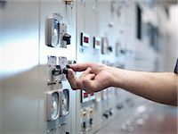 Close up of hand adjusting control in nuclear power station control room simulator Stock Photo - Premium Royalty-Freenull, Code: 649-07585709