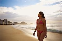 Mature woman strolling on Copacabana beach, Rio De Janeiro, Brazil Stock Photo - Premium Royalty-Freenull, Code: 649-07585728