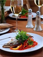 Sea bass in a restaurant table setting Stock Photo - Premium Rights-Managed, Artist: foodanddrinkphotos, Code: 824-07585854