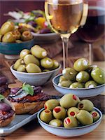 Stuffed olives with bruschetta and wine Stock Photo - Premium Rights-Managed, Artist: foodanddrinkphotos, Code: 824-07586052