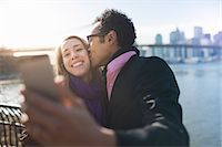 Young couple taking selfie and kissing, New York, USA Stock Photo - Premium Royalty-Freenull, Code: 614-07587554