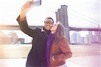 Young couple taking self portrait next to Brooklyn Bridge, New York, USA Stock Photo - Premium Royalty-Freenull, Code: 614-07587555