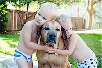 Portrait of old dog and toddler twins Stock Photo - Premium Royalty-Freenull, Code: 614-07587564