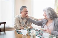 Affectionate mature adult couple having lunch at home Stock Photo - Premium Royalty-Freenull, Code: 614-07587710