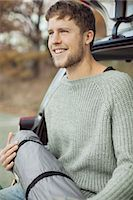 Young man with sleeping bag at car's trunk Stock Photo - Premium Royalty-Freenull, Code: 698-07587731