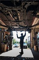Full length of mechanic working in auto repair shop Stock Photo - Premium Royalty-Freenull, Code: 698-07587819