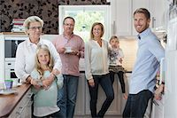 popping (bursting not corks or pimples) - Portrait of happy multi-generation family in kitchen Stock Photo - Premium Royalty-Freenull, Code: 698-07587832