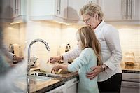 Grandmother and granddaughter washing vegetables in kitchen Stock Photo - Premium Royalty-Freenull, Code: 698-07587839