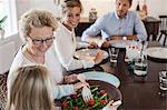 Multi-generation family having lunch at dining table