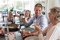 Happy family having lunch together at home Stock Photo - Premium Royalty-Freenull, Code: 698-07587854