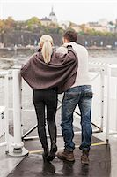 Rear view of young couple leaning on railing outdoors Stock Photo - Premium Royalty-Freenull, Code: 698-07587949