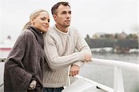 Young couple leaning on railing outdoors Stock Photo - Premium Royalty-Freenull, Code: 698-07587950