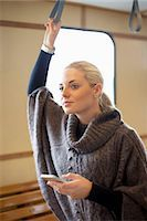 Young woman with mobile phone standing on ferry Stock Photo - Premium Royalty-Freenull, Code: 698-07587953