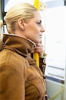 Side view of woman holding railing on bus Stock Photo - Premium Royalty-Freenull, Code: 698-07587971