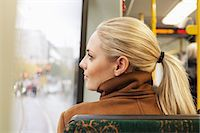 Rear view of woman looking out through bus window Stock Photo - Premium Royalty-Freenull, Code: 698-07587974