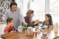 Family having breakfast together at home Stock Photo - Premium Royalty-Freenull, Code: 698-07587983
