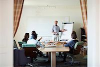 Senior businessman giving presentation in board room Stock Photo - Premium Royalty-Freenull, Code: 698-07588031