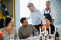 five people - Waiter serving water to business people at restaurant with chef standing in background Stock Photo - Premium Royalty-Freenull, Code: 698-07588062
