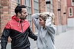 Sporty couple communicating on street