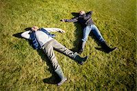 High angle view of mature couple lying on grass Stock Photo - Premium Royalty-Freenull, Code: 698-07588179
