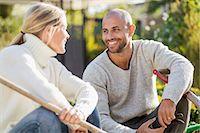 Mature couple with gardening equipment sitting at yard Stock Photo - Premium Royalty-Freenull, Code: 698-07588190
