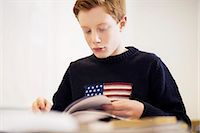 pennant flag - High school boy reading book in classroom Stock Photo - Premium Royalty-Freenull, Code: 698-07588226