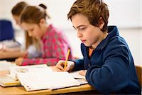 High school students studying at desk in classroom Stock Photo - Premium Royalty-Freenull, Code: 698-07588239