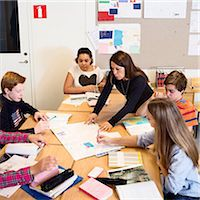 Teacher explaining chart to high school student in classroom Stock Photo - Premium Royalty-Freenull, Code: 698-07588275