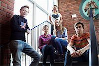 Portrait of confident friends on high school steps Stock Photo - Premium Royalty-Freenull, Code: 698-07588299
