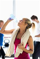 Fit young woman drinking water at health club Stock Photo - Premium Royalty-Freenull, Code: 698-07588320