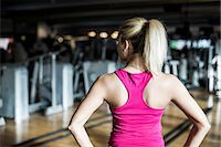 Rear view of fit young woman at gym Stock Photo - Premium Royalty-Freenull, Code: 698-07588325