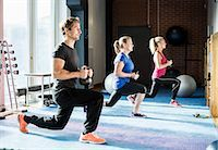 Customers exercising with kettlebells at gym Stock Photo - Premium Royalty-Freenull, Code: 698-07588327