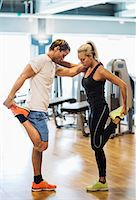 Friends doing stretching exercise together at gym Stock Photo - Premium Royalty-Freenull, Code: 698-07588348