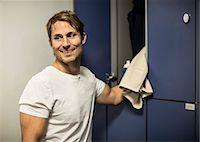 Happy man locker room at health club Stock Photo - Premium Royalty-Freenull, Code: 698-07588351