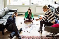 Business people conversing in creative office Stock Photo - Premium Royalty-Freenull, Code: 698-07588430
