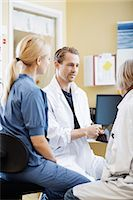 Doctors and nurse discussing over digital tablet in hospital Stock Photo - Premium Royalty-Freenull, Code: 698-07588475
