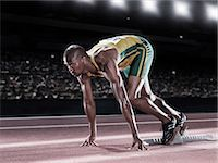 race track (people) - Runner poised at starting line on track Stock Photo - Premium Royalty-Freenull, Code: 6113-07588628