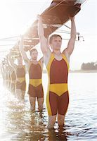 sport rowing teamwork - Rowing team carrying boat overhead on lake Stock Photo - Premium Royalty-Freenull, Code: 6113-07588643