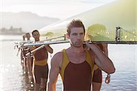 sport rowing teamwork - Rowing team carrying scull out of lake Stock Photo - Premium Royalty-Freenull, Code: 6113-07588670