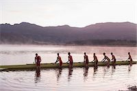 sport rowing teamwork - Rowing crew placing scull in lake at dawn Stock Photo - Premium Royalty-Freenull, Code: 6113-07588680