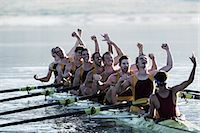 sport rowing teamwork - Rowing team celebrating in scull on lake Stock Photo - Premium Royalty-Freenull, Code: 6113-07588684