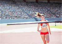 race track (people) - High jumper nearing pole Stock Photo - Premium Royalty-Freenull, Code: 6113-07588693