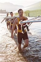 fit people - Rowing team carrying scull in lake Stock Photo - Premium Royalty-Freenull, Code: 6113-07588717