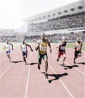 sprint - Runners racing on track Stock Photo - Premium Royalty-Freenull, Code: 6113-07588732