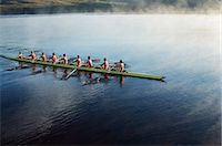 sport rowing teamwork - Rowing crew rowing scull on lake Stock Photo - Premium Royalty-Freenull, Code: 6113-07588738
