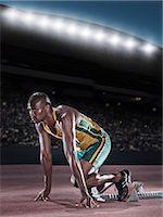 runner (male) - Runner poised at starting block on track Stock Photo - Premium Royalty-Freenull, Code: 6113-07588769