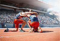 runner (male) - Runners huddled on track Stock Photo - Premium Royalty-Freenull, Code: 6113-07588788